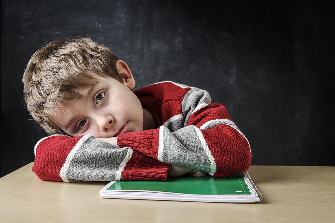 bored kid in class school sux